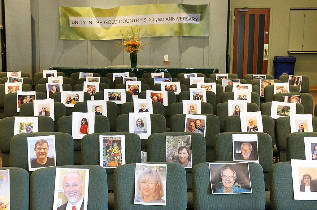 The photos of the smiling faces of Unity in the Gold Country's congregation helps Rev. Jerry Farrell forget that he is currently unable to give sermons to the group in person due to COVID-19 concerns.