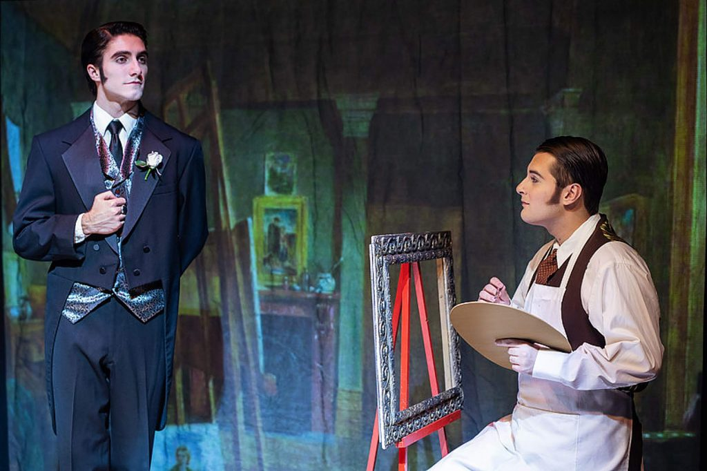 Cameron Akkerman as Dorian Gray poses for the portrait painted by Basil Hallward (Andrew Tindall) that changes his life forever in Sierra College's upcoming thriller,