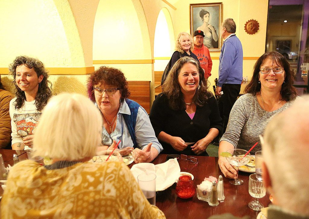 Nevada City Council candidate Daniela Fernandez, from left, Councilwoman Erin Minett, Nevada County District 1 Supervisor Heidi Hall, and Nevada Irrigation District 1 Director Ricki Heck sit at an election watch party at Margarita's Restaurant in Grass Valley Tuesday evening. First time candidate Fernandez and incumbent Hall were both on the Super Tuesday ballot.