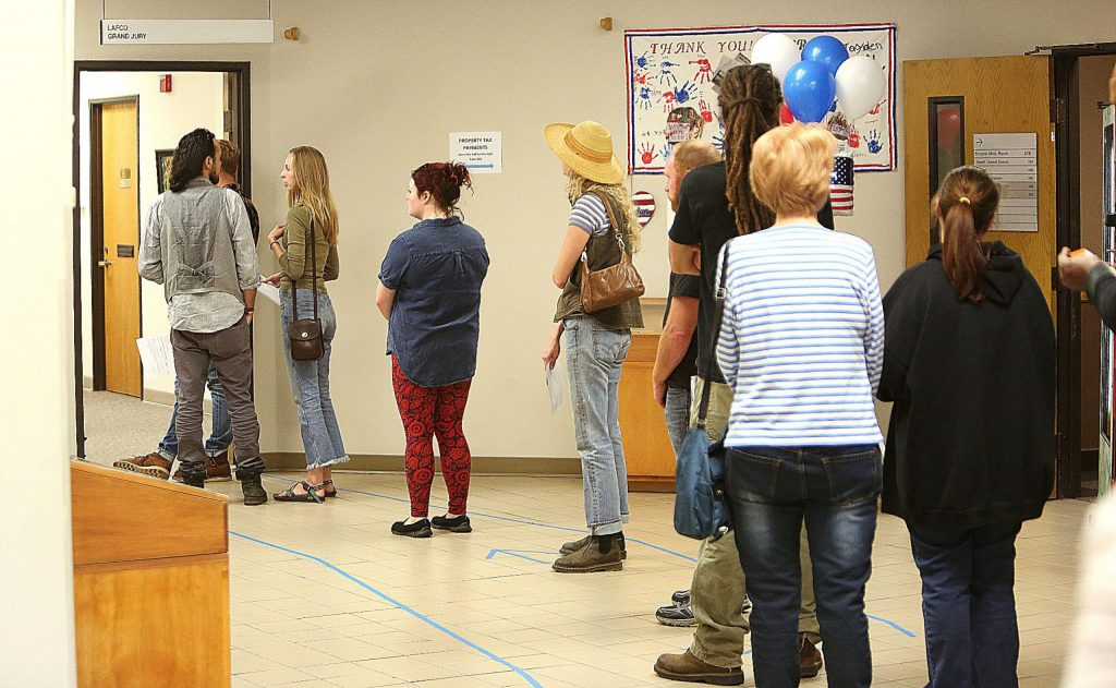 The line was out the door and into the upstairs lobby at the Rood Center voting location Tuesday afternoon.