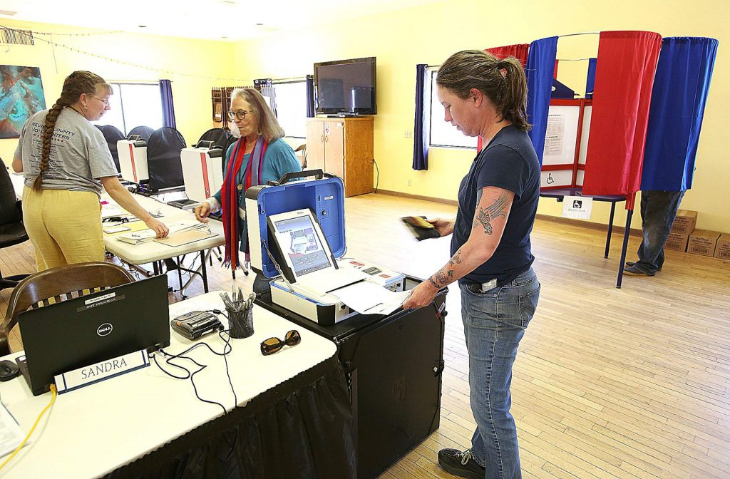 A voter casts her ballot at the North San Juan vote center Tuesday afternoon.