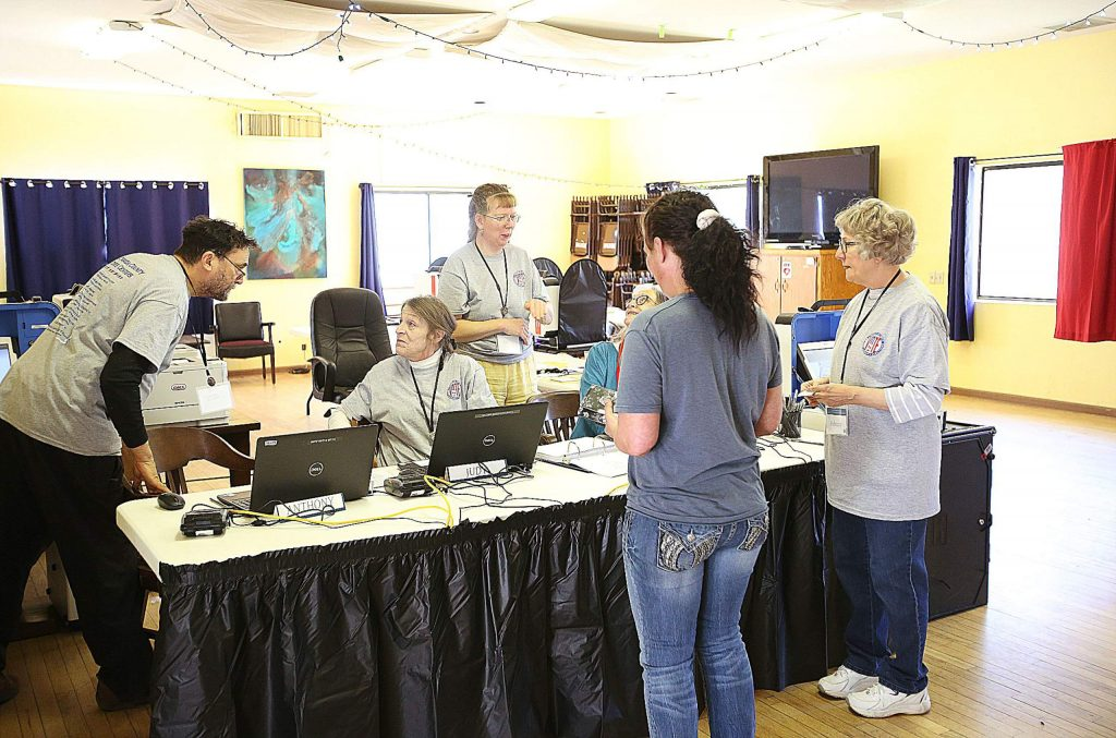 Voters get help casting their ballot at the North San Juan vote center Tuesday.