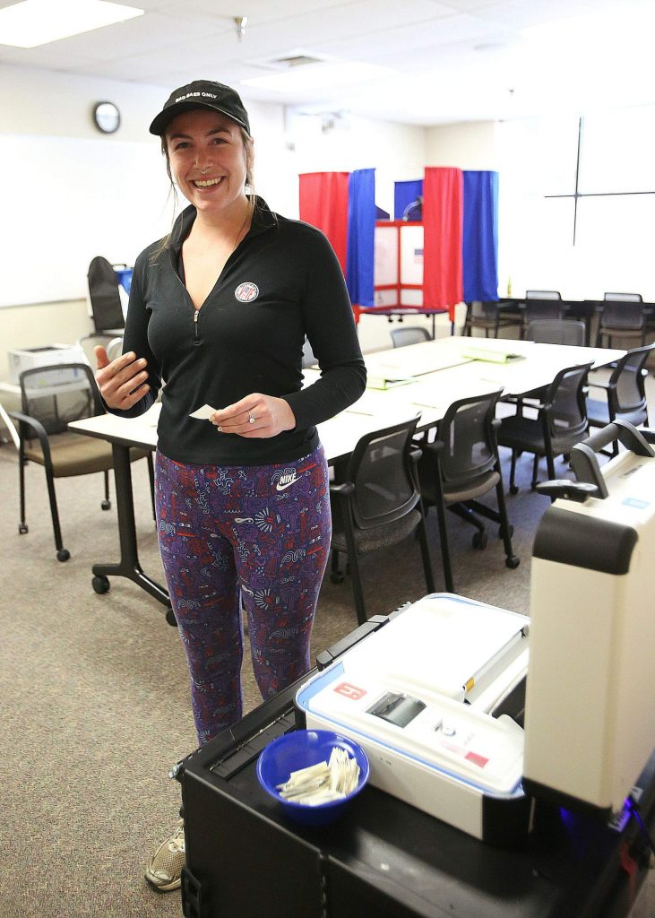 Nevada City's Anina Lewerence casts her ballot Saturday during the first day of early voting at Nevada County Vote Centers in advance of Tuesday's primary elections.