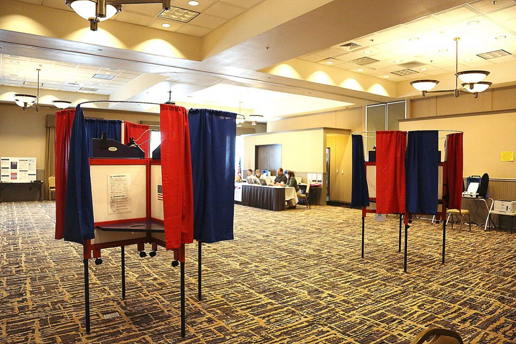 the traditional screened voting tables are available for privacy while voting before ballots are fed into a machine at the Grass Valley vote center in the Gold Miners Inn.