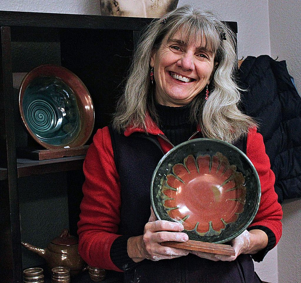 Chic Lotz started the Hospitality House Empty Bowl fundraiser in 2006. In this 2017 file photo, she shows the kind of larger-size art bowl that patrons can bid on at the March 14 Empty Bowl silent auction.