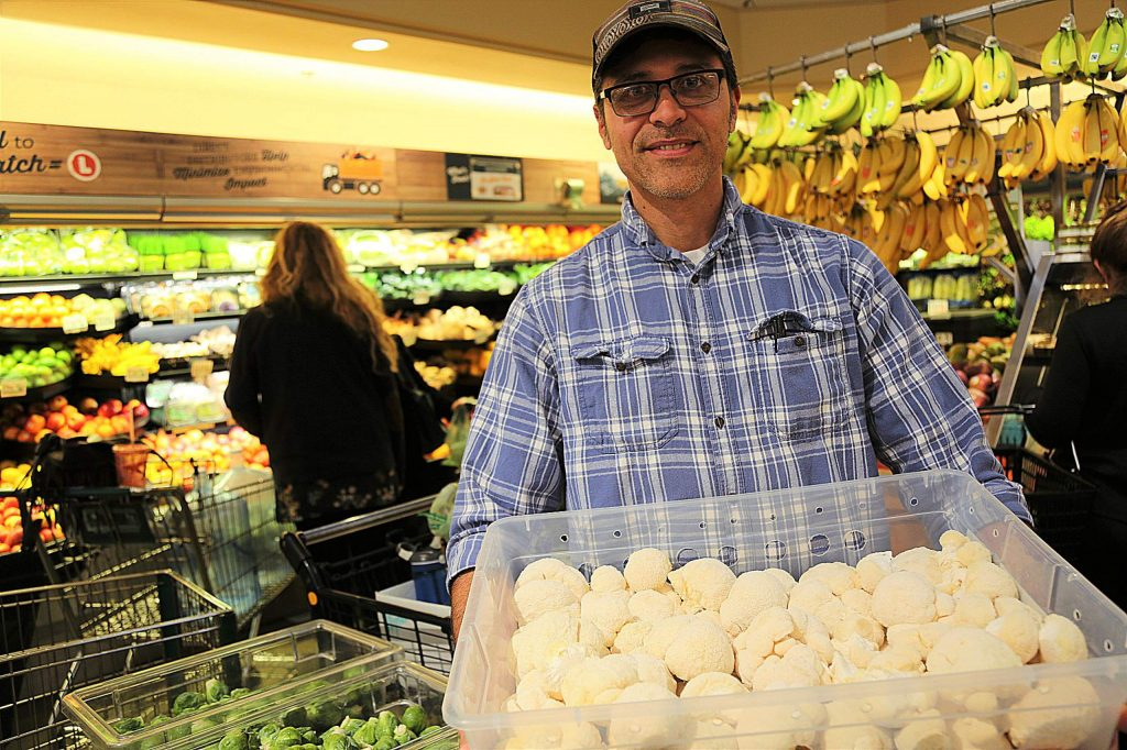 Joel Gutierrez of Foothill Fungi brings in a shipment of Lion's Mane mushrooms to the Produce Department of BriarPatch Food Co-op. The grocery store regularly sells out of Lion's Mane in a day.