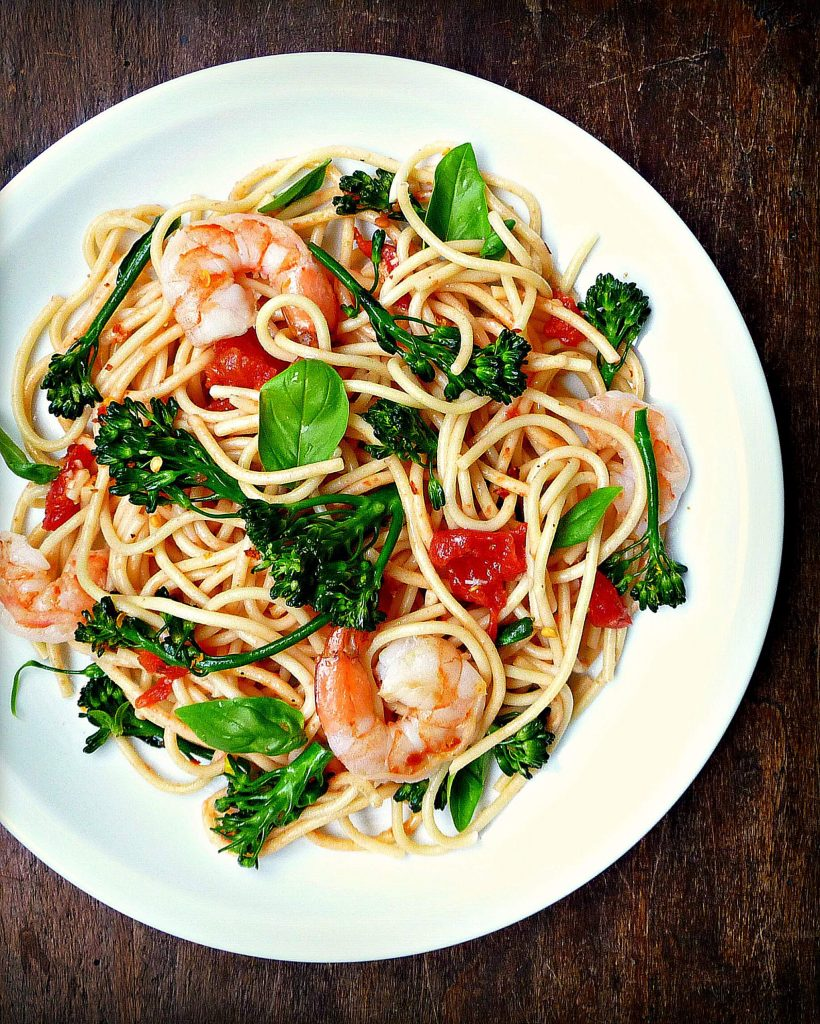 Crisp-tender broccolini spears and plump, briny shrimp mingle in a quick-cooked, three-ingredient tomato sauce infused with garlic. It's fresh and bright, and can be whipped up in 30 minutes for a healthy weeknight dinner that's low-maintenance and utterly delicious.