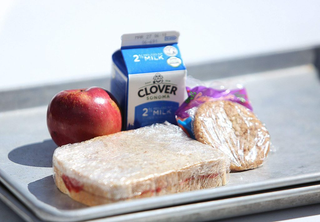 The free lunches consist of a peanut butter and jelly sandwich on Truckee sourdough with home made jam. A snickerdoodle or chocolate chip cookie, a bag of carrots, an apple and a milk. Emily's Catering and Cakes has agreed to four Friday's of giving the meals away with the help of donations from customers.