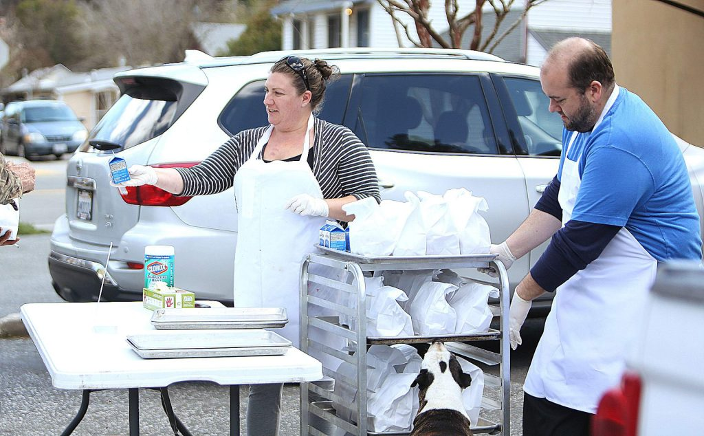 Emily Scott and John Arbaugh of Emily's Catering and Cakes began the first of four free lunch Fridays last week where the two were prepared to give away 100 meals for school aged children in need during this time.