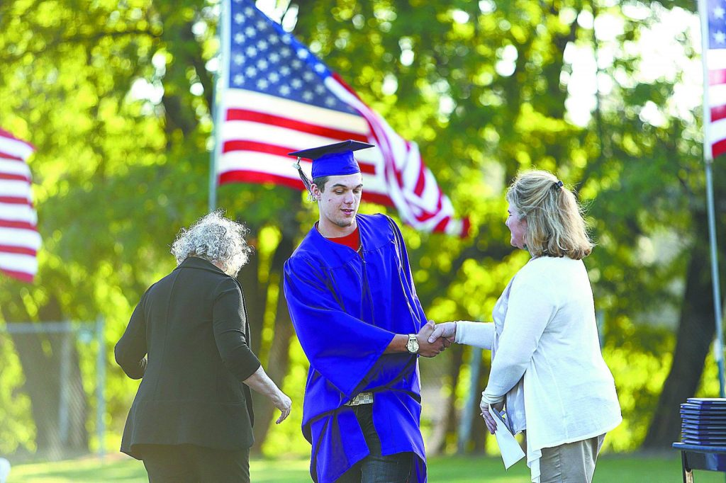 Silver Springs Graduate Dylan Hobbs accepts a scholarship from the Associated California Loggers group for $750 during a graduation ceremony last year. Silver Springs has significantly reduced suspensions this year in comparison with the one prior.