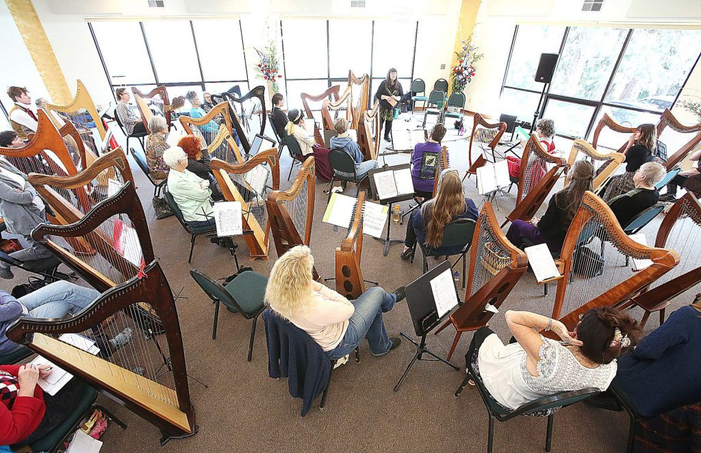World renowned harpist Christina Tourin — of Emerald Harp Productions and International Harp Therapy Program — holds a harp workshop for about 40 people Friday at Peace Lutheran Church in Grass Valley.