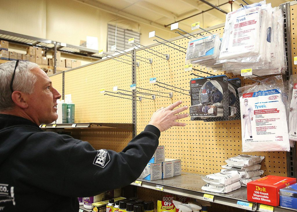Hills Flat Lumber assistant store manager Steve Waldron shows the only two masks left on the shelves of the Grass Valley hardware store. All N100 and N95 masks fly off of the shelves when shipments come in. Waldron said masks are on back order until April.