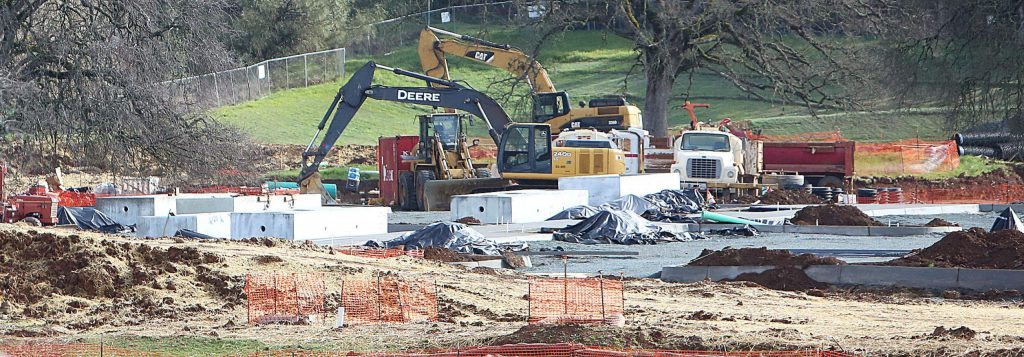 Earth-moving equipment makes way for foundations to be laid at the Higgins Marketplace.