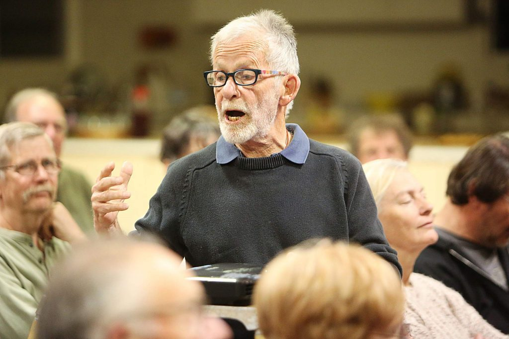 """Local historian and nature lover Hank Meals, talks to the crowd gathered at the Banner Grange Community Hall off of McCourtney Road Saturday where he gave the second to last of his """"Just Enough"""" history talks which focused on life in Northern California and Nevada County after the Gold Rush."""