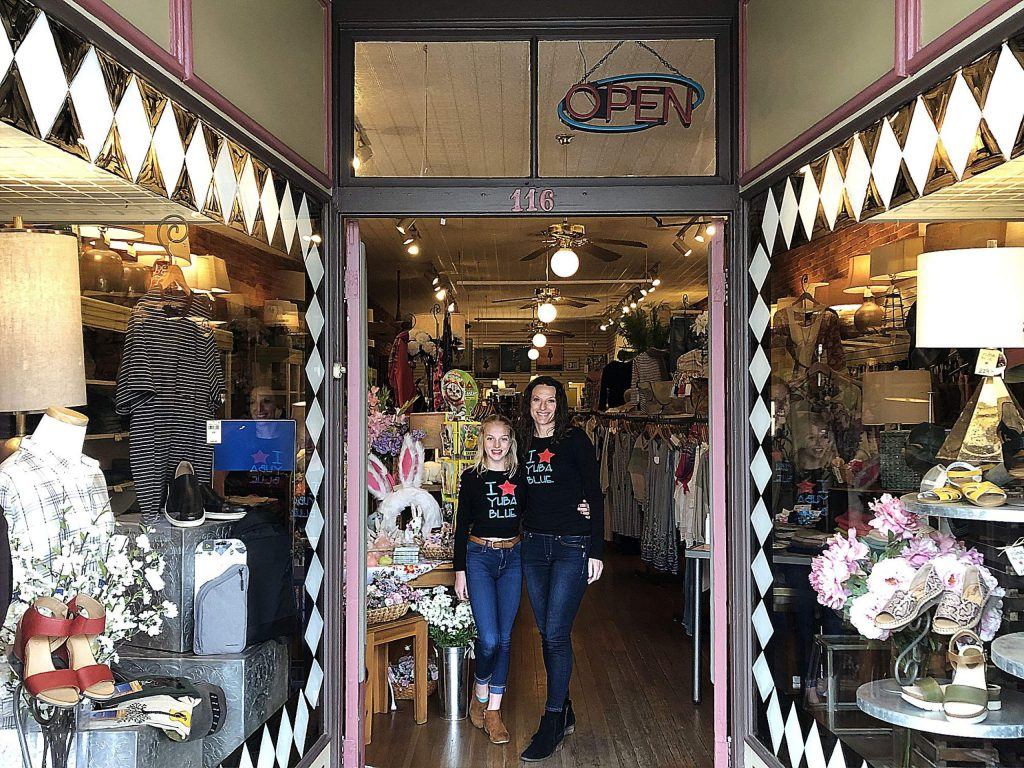Lillie Piland-Robertson with her daughter Elle Piland outside Yuba Blue in Grass Valley. The physical store is closed, but Yuba Blue has moved to a digital space in order to continue selling their product.