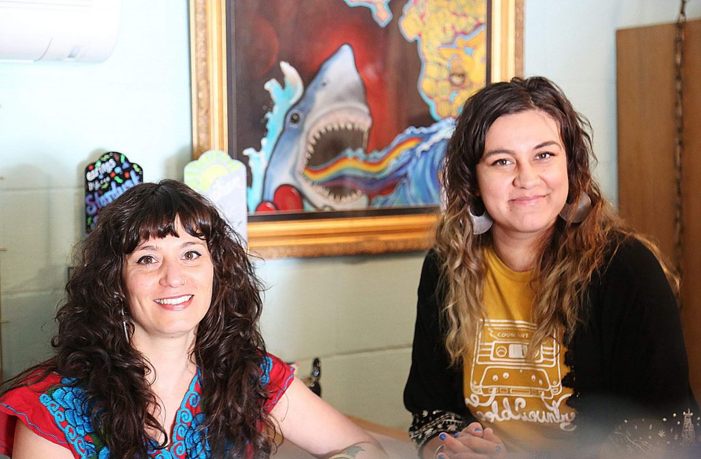 Stephanie Arduini and Annie Kendall are the two behind Cosmic Shark Clothing, the name of which is a tribute to a painting created by the duo years ago and now on display in their downtown Grass Valley clothing shop.
