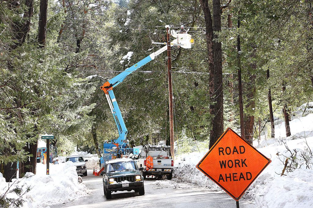 PG&E crews work to restore infrastructure along Pasquale Road while Cascade Shores residents navigate around the line workers. Some 1,426 customers were without electricity in Nevada County as of Thursday morning. By Thursday afternoon, that number rose to 1,815 without power in the county. By 5:30 p.m. Thursday that number was at 1,620.