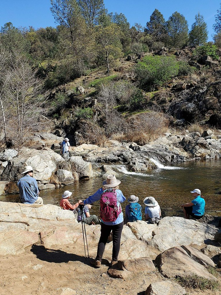 German American hiking club taking a break at dry creek on the way to Fairy Falls in Spenchville Preserve.