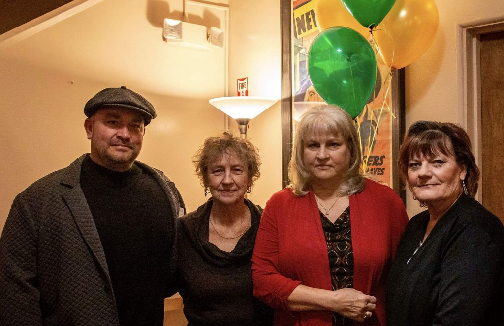 Four members of the Board of Directors of Gold Country Senior Services' at the Feb. 22 premier of the movie about the Senior Firewood Program.