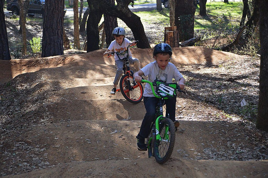 Dominic and Damien practicing their biking skills at the Western Gateway Bike Park.