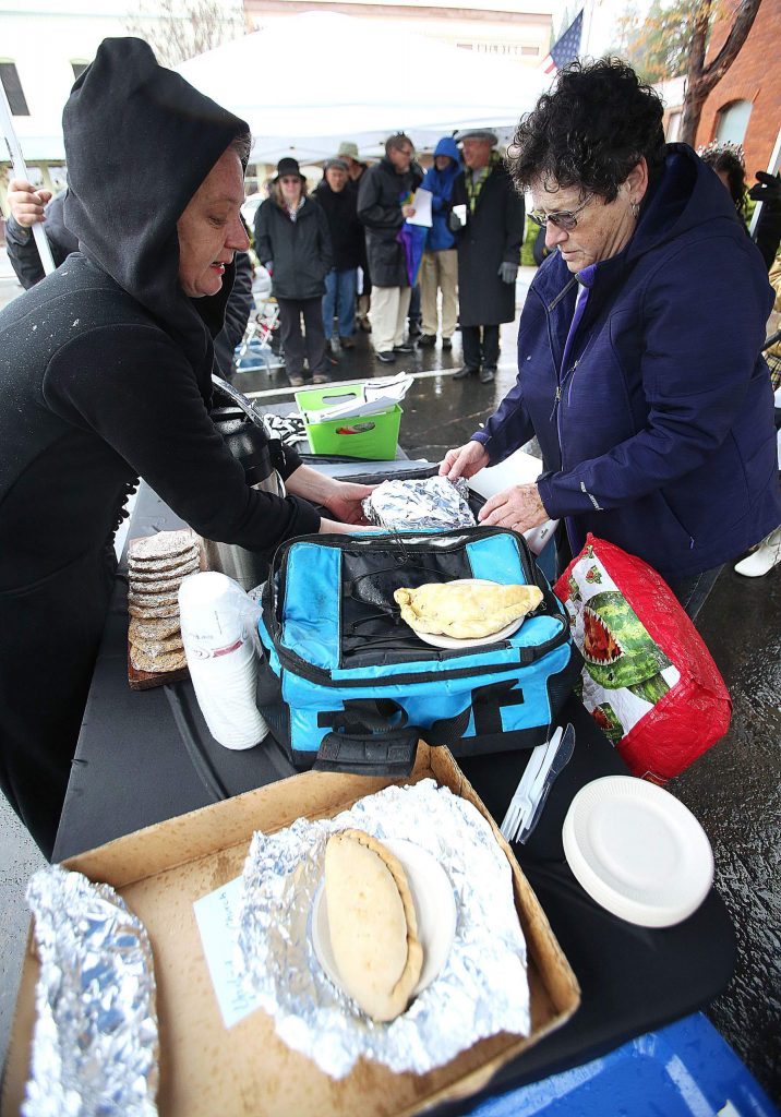 Downtown Grass Valley Association's Marni Marshall (left) and Grass Valley Male Voice Choir founder and director Eleanor Kenitzer, prepare the pasty's for the human taste test following the annual pasty tossin' Pasty Olympics in honor of St. Piran's day. This was one of the final events held by the city of Grass Valley before the social distancing went into effect.
