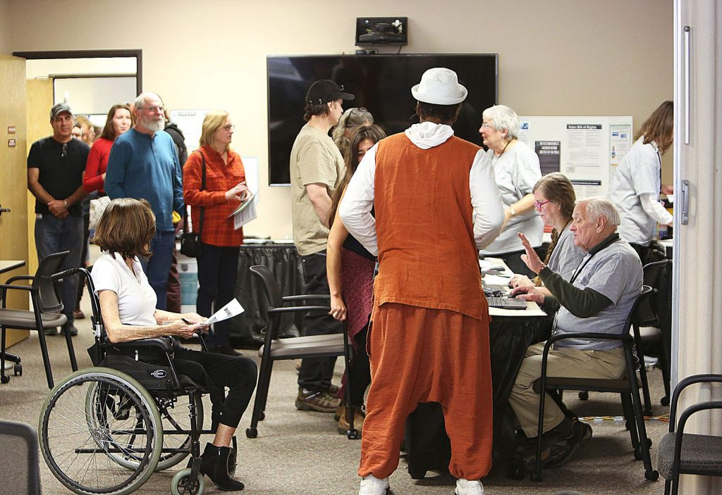 Voting procedures at the Rood Government Center on Super Tuesday showed waiting in lines among many people in close quarters. The system may need to see some changes come November if social distancing is still in effect.