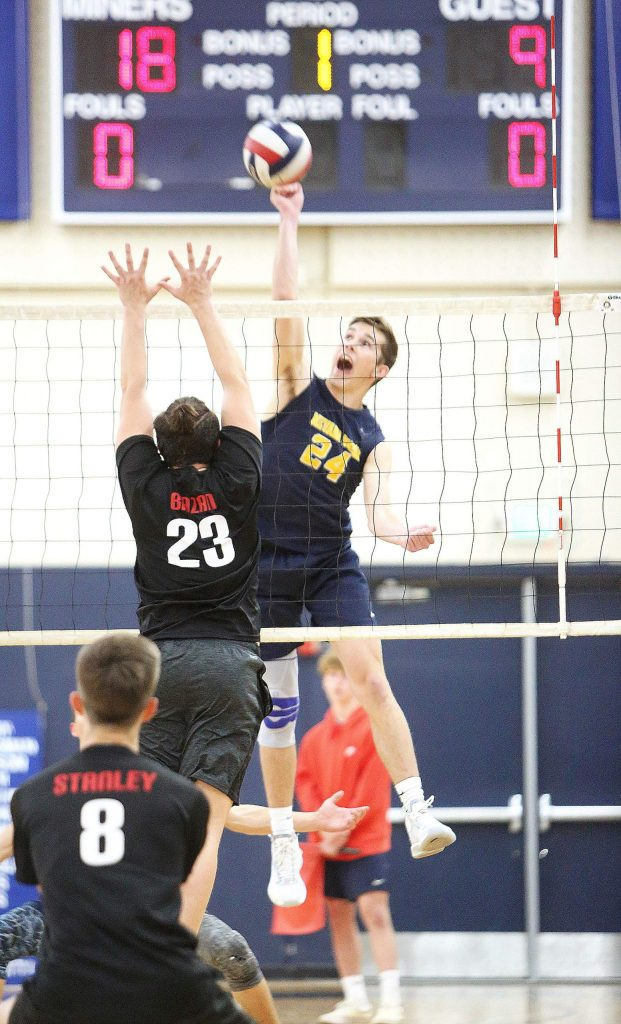Nevada Union's Judah Myers (24) spikes the ball during one of the boys volleyball team's last games before the coronavirus shutdowns March 12.