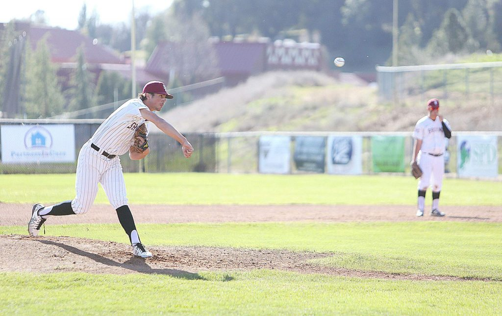 Bear River starting pitcher Colton Jenkins (2) fires a pitch for a strike-out during Thursday's home win over Center High School.