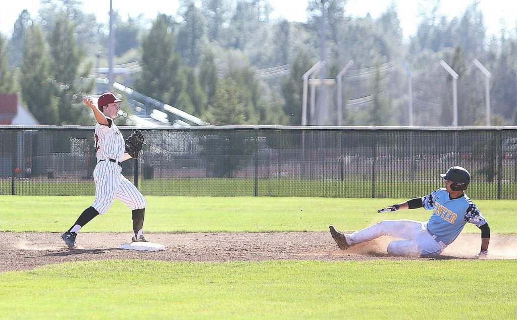 Bear River infielder Devin Ortiz gets the out at second base before attempting a double play at first base during Thursday's home game against Center.
