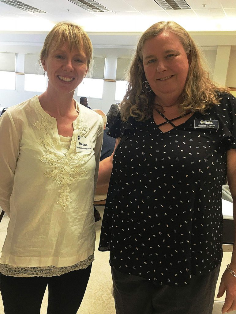 Martine Beals, a Habitat for Humanity home owner, catches up with Habitat's executive director Lorraine Larson.