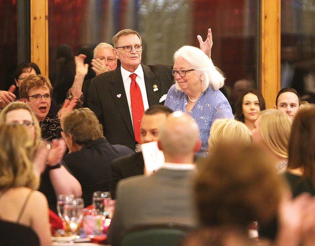 Bill and wife Susan Drown were given a standing ovation as they were recognized during Saturday night's Red Light Ball.