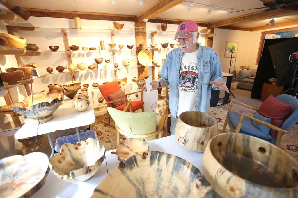 Nevada City's Mike Snegg stands among his collection of wooden bowls the majority of which are made out of Norfolk Island Pine. SneggÕs collection will be featured in the SmithsonianÕs 38th annual Smithsonian Craft Show, April 22 through 26.