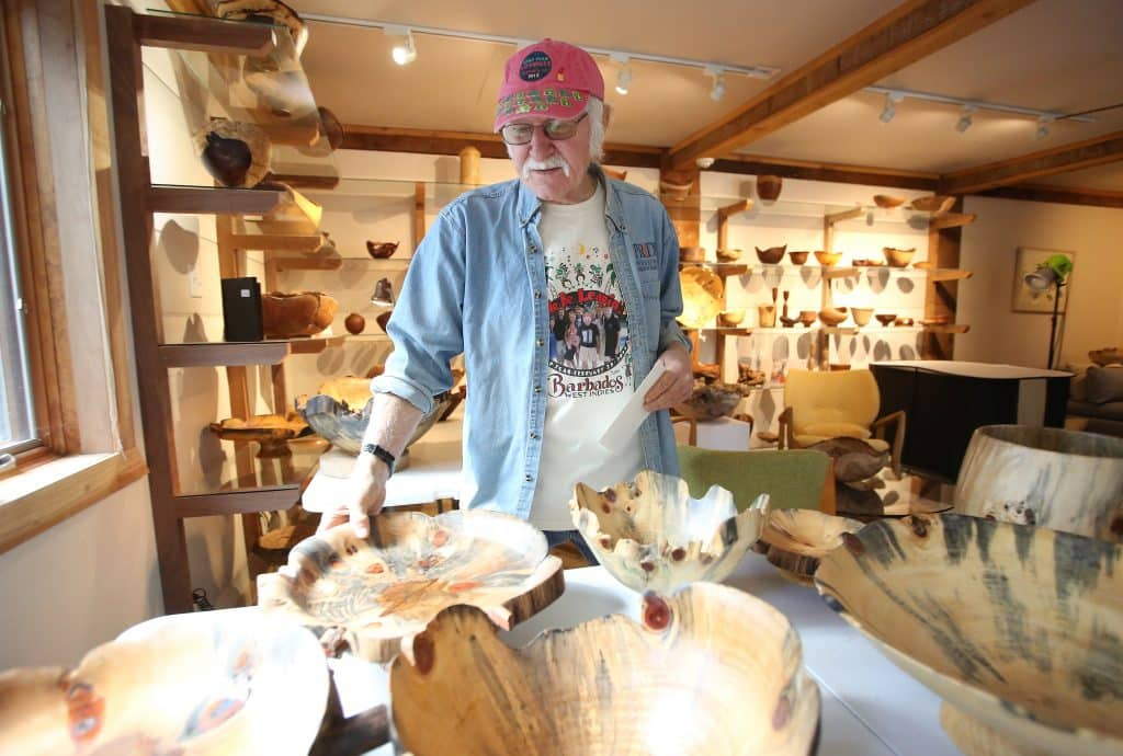Woodturner Mike Snegg has a selection of wooden bowls that he will be taking to the Smithsonian's Craft Show in April. Others he is still crafting in his Nevada City shop.