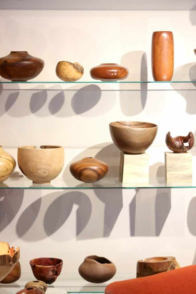 Some of Mike Snegg's bowls on display in his home gallery.