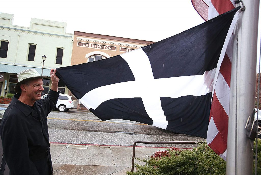 The St. Piran's Day Cornish flag of Cornwall England, is raised for the day Saturday to commemorate Grass Valley's celebration of their Cornish mining heritage and St. Piran's Day.