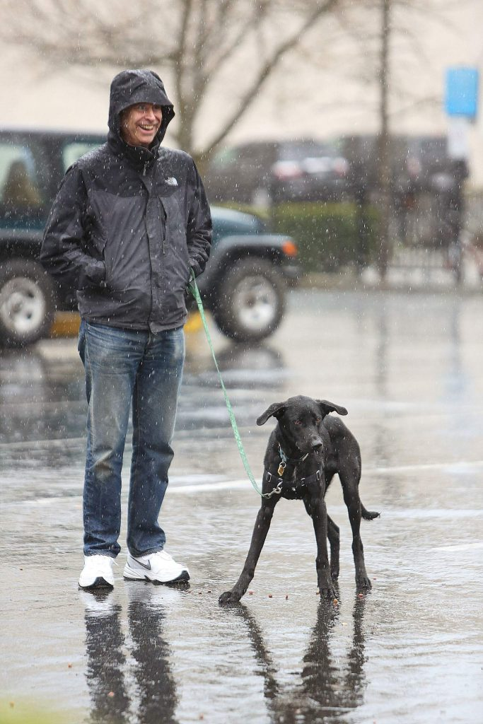 A pair of spectators await an errant toss of a pasty during the Pasty Olympics held despite Saturday morning's pouring rain.