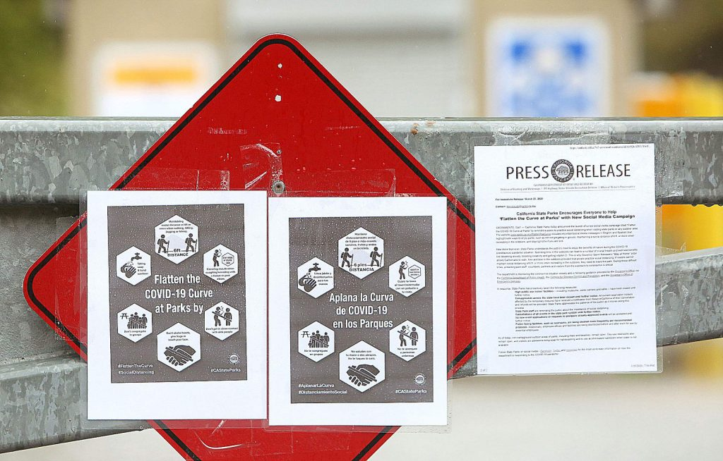 Tips on how to stay safe while on the State Park trails is displayed on a gate to a closed parking lot near the Bridgeport Bridge. The lot, and many others within the California State Park's Sierra District, have closed due to COVID-19 concerns.