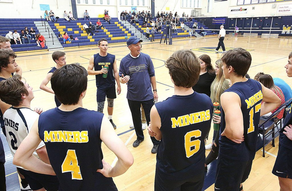 Nevada Union Miners boys volleyball varsity head coach Lance Mansuetti talks to his team in between sets during Wednesdays home game against the Miners.
