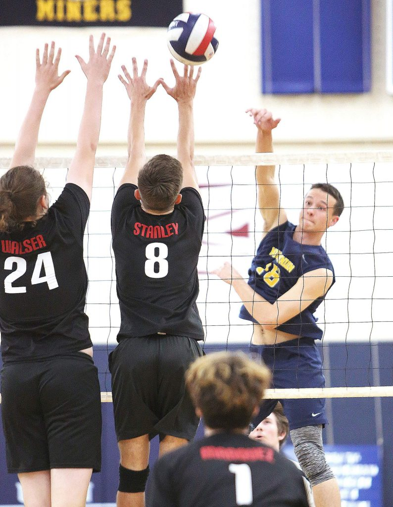 Nevada Union senior Preston Nowak (18) lobs the ball over the net during Wednesday's home matchup against Antelope.