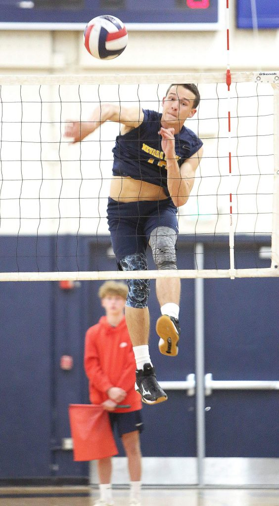 Nevada Union senior Preston Nowak (18) scores one of his 16 kills during a win over Antelope High School Wednesday evening at Albert Ali Gymnasium.