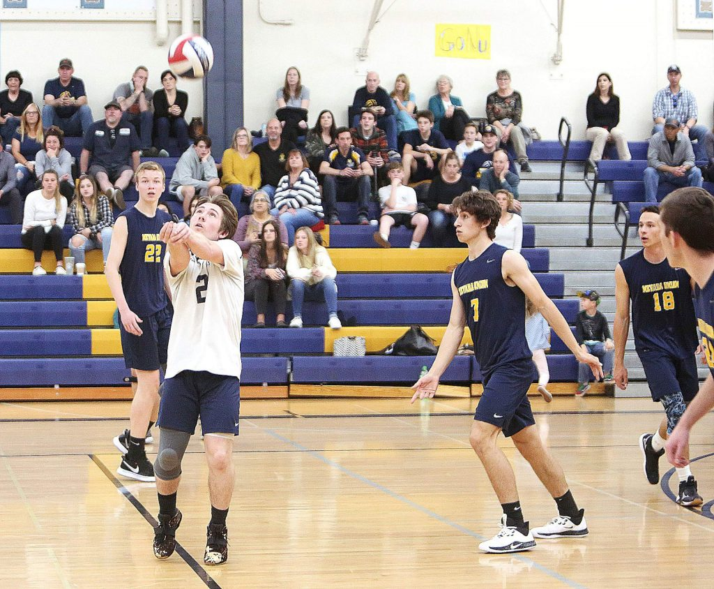 Nevada Union libero J. Youngman (2) bumps the ball, setting up his teammates for a play against Antelope Wednesday at home.