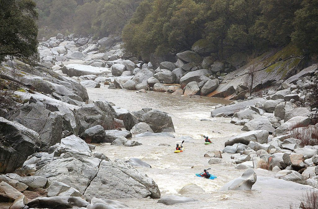 A trio of kayakers take advantage of the recent rainfall and the increase of water flow along the South Yuba River Sunday afternoon. Between 2.5 and 4.5 inches of rain fell in Nevada County over the past 72 hours.