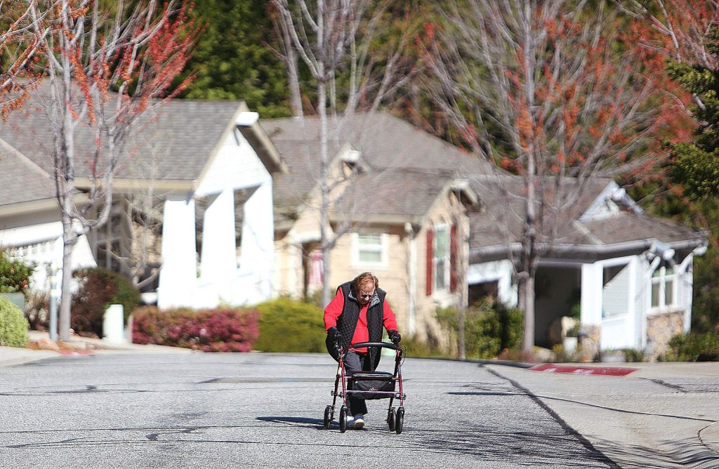 Adele Frickman, who just turned 98 years old, makes her way up Sparrow Circle at Grass Valley's Eskaton senior living community earlier this month. Frickman and other members of the neighborhood make the morning rounds to let people know theyre ok and to check on others.