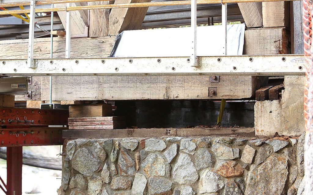 The wooden frame of the Bridgeport Bridge has been separated from its foundation. Workers can now move forward with construction of the bridge's new foundation. The final restoration date is estimated for fall of this year.