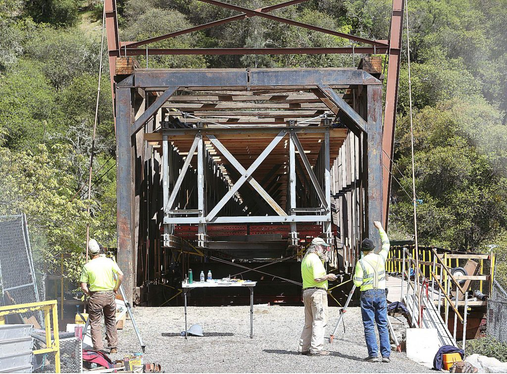 """The metal """"Mabey Bridge"""" that was installed last November can be seen extended through the center of the wooden structure helping to support the frame and scaffolding while workers replace major structural timbers."""