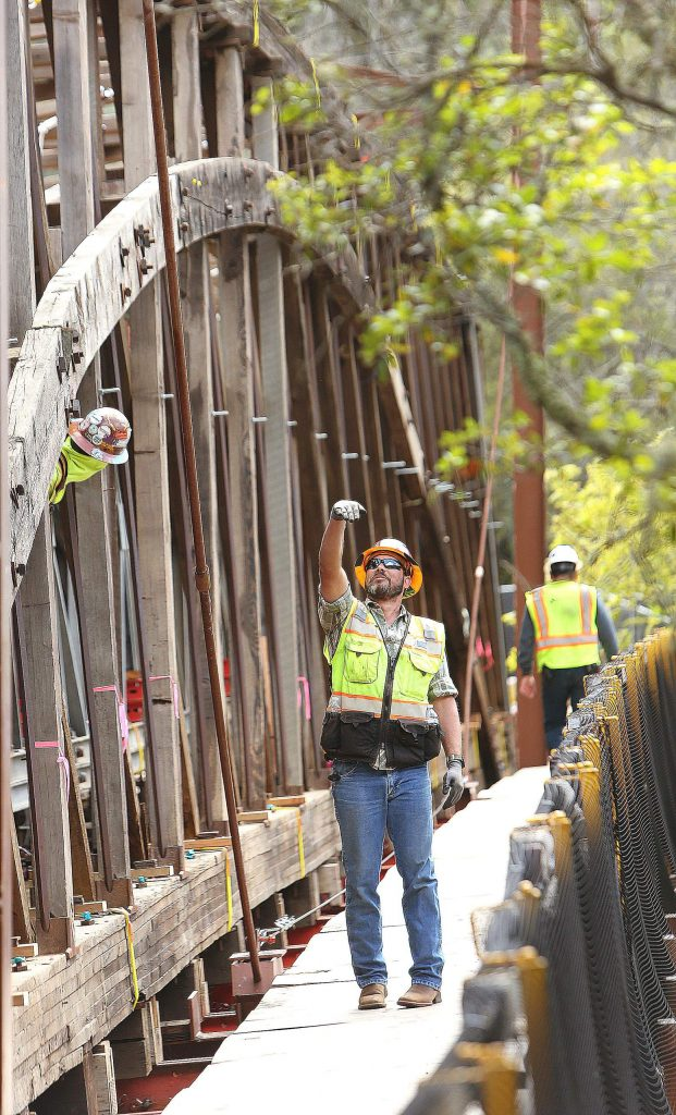 After a four-month hiatus, restoration work on the Bridgeport Covered Bridge has begun again. Spectra Historic Construction workers have been busy raising the Bridgeport Bridge off its foundation and started replacing structural timbers.