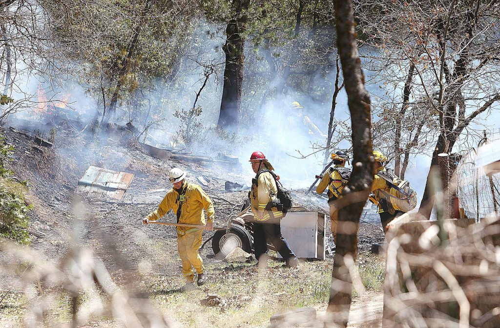 Cal Fire and City of Grass Valley firefighters work to contain an escaped burn pile off of the 12,000 block of Gold Starr Lane April 16 in rural Grass Valley. The fire was quickly knocked down and kept to less than 1/4 of an acre.