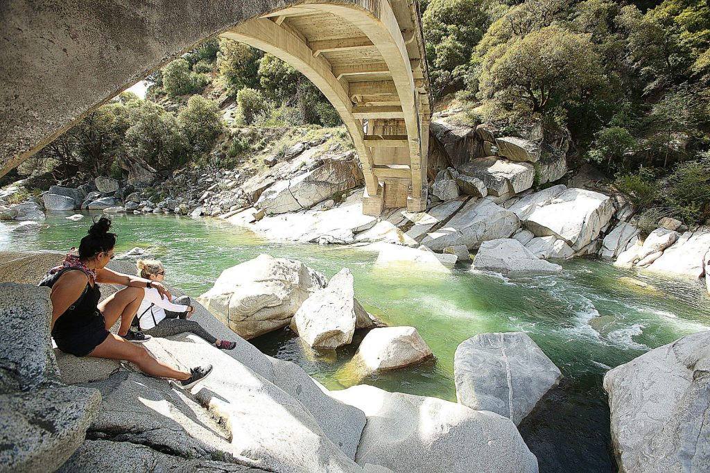 "Jen Buchignani and friend Lory Driver enjoy a peaceful moment under the South Yuba River Bridge on Earth Day. ""Our mother is happy today,"" Buchignani said."
