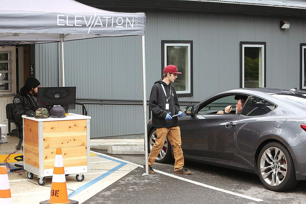 The staff at Nevada City's cannabis dispensary, Elevation 2477', are finding ways to adapt to COVID-19 concerns by offering online ordering as well as parking lot pickup. The cannabis industry, considered an essential service, has continued as the coronavirus upends the lives of local residents.