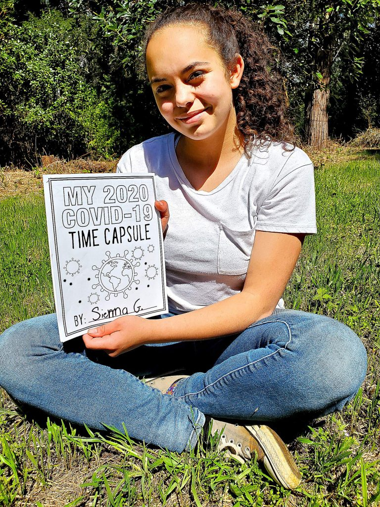 Sienna Goodman, a Grizzly Hill School eighth grader, with her time capsule packet. Grizzly Hill is having its students capture how they feel during the pandemic. The capsule will be unearthed in 10 years.